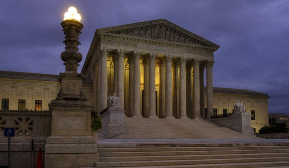 FILE - This Oct. 5, 2018, file photo shows the U. S. Supreme Court building before dawn in Washington. The Supreme Court term has steered clear of drama since the tumultuous confirmation of Justice Brett Kavanaugh. The next few weeks will test whether the calm can last. (AP Photo/J. David Ake, File)