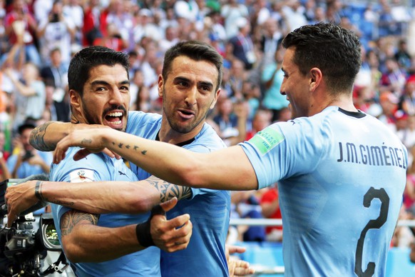 epa06824936 Luis Suarez (L) of Uruguay celebrates with his teammates after scoring the 1-0 lead during the FIFA World Cup 2018 group A preliminary round soccer match between Uruguay and Saudi Arabia in Rostov-On-Don, Russia, 20 June 2018.  (RESTRICTIONS APPLY: Editorial Use Only, not used in association with any commercial entity - Images must not be used in any form of alert service or push service of any kind including via mobile alert services, downloads to mobile devices or MMS messaging - Images must appear as still images and must not emulate match action video footage - No alteration is made to, and no text or image is superimposed over, any published image which: (a) intentionally obscures or removes a sponsor identification image; or (b) adds or overlays the commercial identification of any third party which is not officially associated with the FIFA World Cup)  EPA/KHALED ELFIQI   EDITORIAL USE ONLY