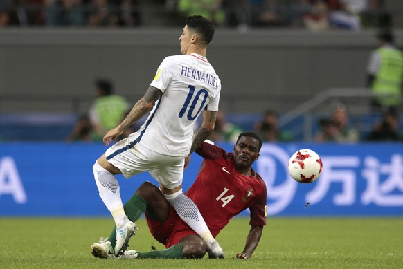Chile's Pablo Hernandez, left, clashes with Portugal's William Carvalho during the Confederations Cup, semifinal soccer match between Portugal and Chile, at the Kazan Arena, Russia, Wednesday, June 28, 2017. (AP Photo/Ivan Sekretarev)