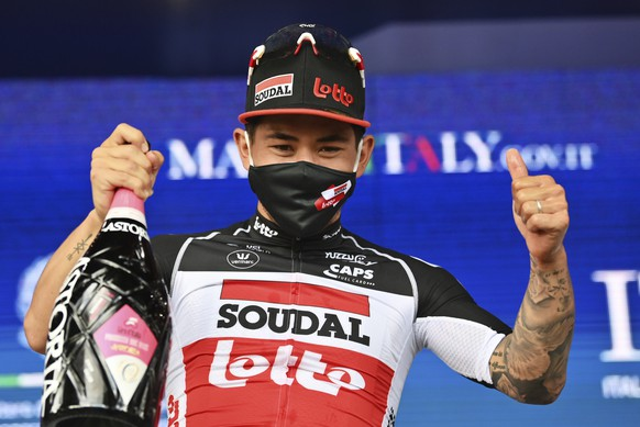 Australia's Caleb Ewan celebrates on the podium after winning the 5th stage of the Giro d'Italia tour of Italy cycling race, from Modena to Cattolica, Italy, Wednesday, May 12, 2021. (Massimo Paolone/LaPresse via AP) Caleb Ewan
