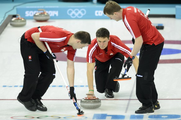 From left, Swiss Sandro Trolliet, Swiss Claudio Paetz and Simon Gempeler in action during the men's curling round robin game between Switzerland and Sweden at the XXII Winter Olympics 2014 Sochi in Sochi, Russia, on Monday, February 10, 2014. (KEYSTONE/Laurent Gillieron)