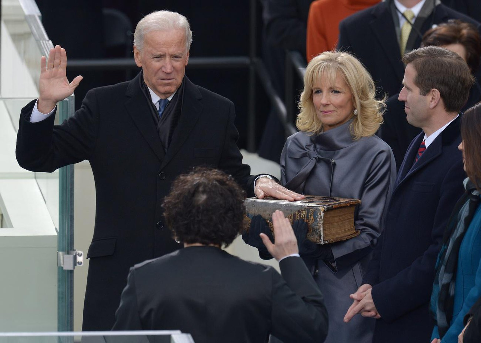 epa03548393 US Vice President Joe Biden (L) places his hand on a bible held by his wife Dr. Jill Biden (C) as he takes the ceremonial oath of office from Supreme Court Justice Sonia Sotomayor (2nd L) before US President Barack Obama is ceremonially sworn in for a second term as the 44th President of the United States in Washington, DC, USA, 21 January 2013. Obama defeated Republican candidate Mitt Romney on Election Day 06 November 2012 to be re-elected for a second term. EPA/JUSTIN LANE