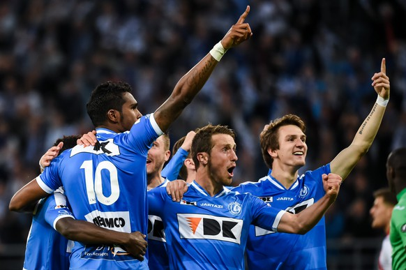 KAA Gent player Renato Neto, left, celebrates with teammates Brecht Dejaegere, center, and Benito Raman after he scored a penalty against Standard Liege during the Jupiler Pro League play-offs match at the Ghelamco Arena in Ghent, Belgium, on Thursday May 21, 2015. (AP Photo/Geert Vanden Wijngaert)