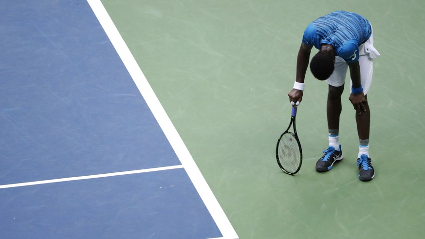 Gael Monfils, of France, reacts after a point to Novak Djokovic, of Serbia, during the semifinals of the U.S. Open tennis tournament, Friday, Sept. 9, 2016, in New York. (AP Photo/Seth Wenig)