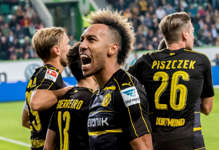 epa05549622 Dortmund's Pierre-Emerick Aubameyang celebrates after scoring the 0-2 goal during the German Bundesliga soccer match between VfL Wolfsburg and Borussia Dortmund at the Volkswagen Arena in Wolfsburg, Germany, 20 September 2016.  EPA/Peter Steffen (EMBARGO CONDITIONS - ATTENTION - Due to the accreditation guidelines, the DFL only permits the publication and utilisation of up to 15 pictures per match on the internet and in online media during the match)