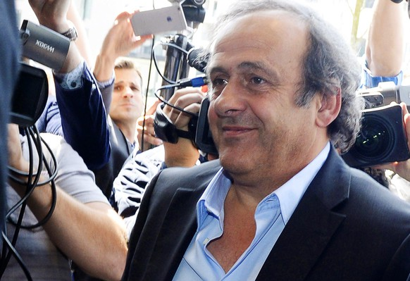 epa04772054 UEFA President Michel Platini arrives for a meeting of the European soccer federation UEFA in the Kameha Grand Hotel in Glattpark-Zurich, ahead of the FIFA Congress in Zurich, Switzerland, 28 May 2015. The FIFA Congress with the president's election takes place on 29 May 2015 in Zurich. The UEFA will decide whether to boycott FIFA's annual Congress following the arrest of top Fifa officials on corruption charges.  EPA/WALTER BIERI