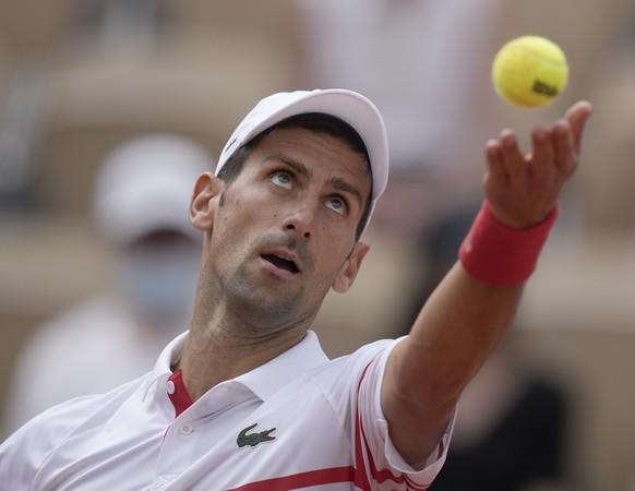 Serbia's Novak Djokovic serves to Uruguay's Pablo Cuevas during their second round match on day 5, of the French Open tennis tournament at Roland Garros in Paris, France, Thursday, June 3, 2021. (AP Photo/Christophe Ena) Novak Djokovic