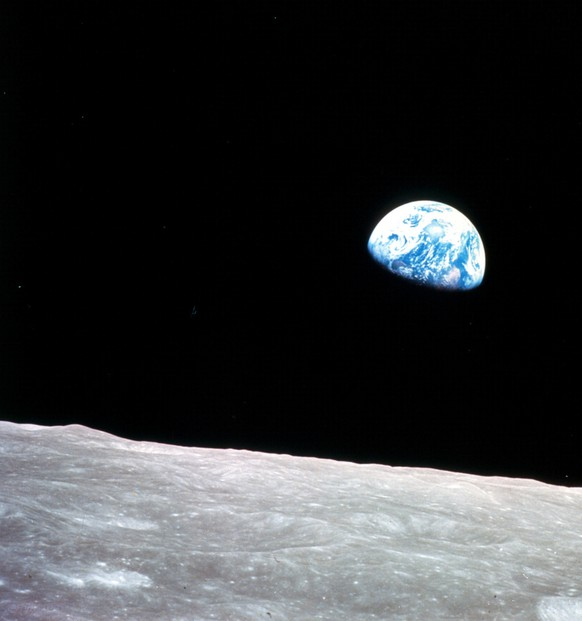 This photo released by NASA shows the Earth rising above the stark Moon, and came from the Apollo 8 mission during the waning days of a chaotic 1968. Apollo 8 astronaut Bill Anders put it in perspective in a documentary he helped pay for: