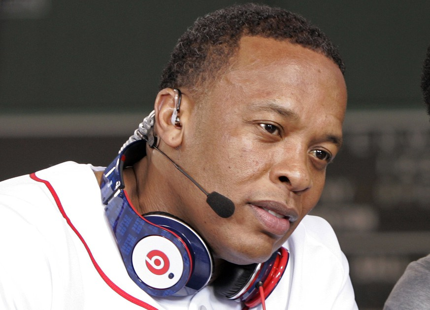 Recording artist Dr. Dre wears a pair of Beats headphones as he attends MLB's 2010 season opener to watch the reigning World Series Champions New York Yankees take on the Boston Red Sox at Fenway Park in Boston, Massachusetts in this file photo taken April 4, 2010.  Apple Inc said it would buy headphone maker Beats Electronics and streaming music provider Beats Music for about $3 billion.   REUTERS/Adam Hunger/Files   (UNITED STATES - Tags: ENTERTAINMENT BUSINESS SPORT)