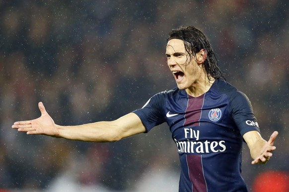PSG's Edinson Cavani reacts during their French League One soccer match between PSG and Marseille at the Parc des Princes stadium in Paris, France, Sunday, Oct. 23, 2016. (AP Photo/Francois Mori)