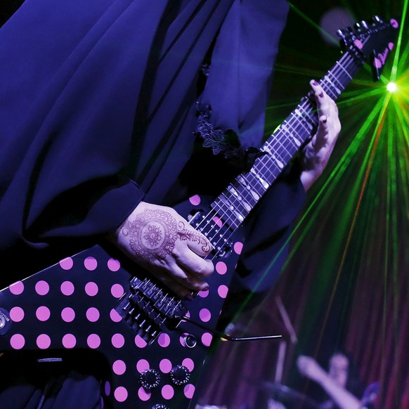 Gisele Marie, a Muslim woman and professional heavy metal musician, plays her Gibson Flying V electric guitar during a concert in Sao Paulo December 16, 2014. Based in Sao Paulo, Marie, 42, is the granddaughter of German Catholics, and converted to Islam several months after her father passed away in 2009. Marie, who wears the Burka, has been fronting her brothers' heavy metal band