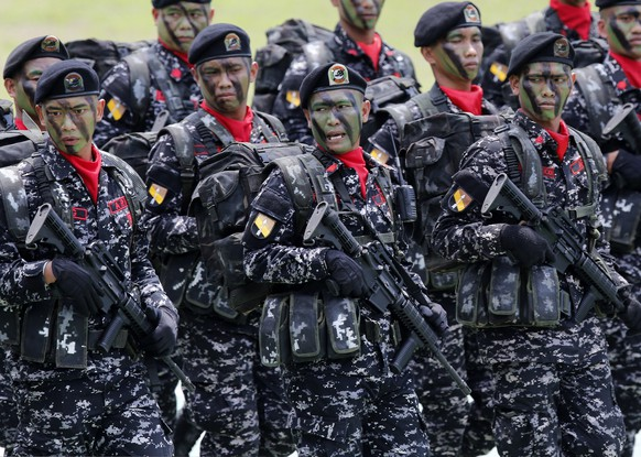 epa05224990 Filipino army soldiers parade during the Philippine Army's 119th Anniversary celebration in Fort Bonifacio, Taguig City, south of Manila, Philippines, 22 March 2016. The Philippine Army boosted its capabilities with the acquisition of more than a hundred US made M113A2 armored personnel carriers (APC) and distribution of more than 60,000 rifles to its personnel amid tension at disputed South China sea.  EPA/FRANCIS R. MALASIG