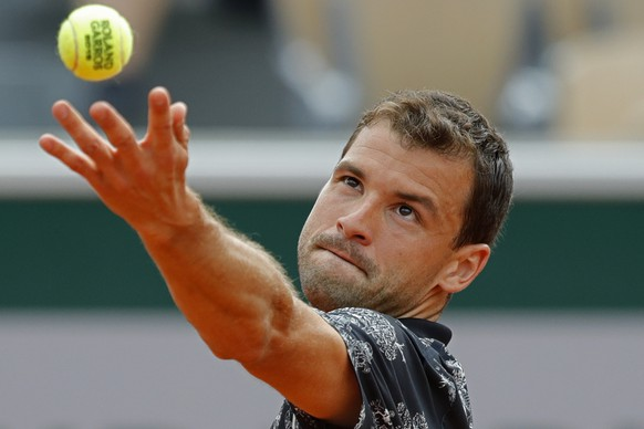Bulgaria's Grigor Dimitrov serves against Croatia's Marin Cilic during their second round match of the French Open tennis tournament at the Roland Garros stadium in Paris, Wednesday, May 29, 2019. (AP Photo/Pavel Golovkin)