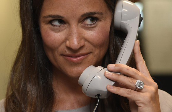 Britain's Pippa Middleton speaks on a telephone as dealers work on a trading floor during a charity day at BGC Partners in the Canary Wharf business district in London, Britain September 12, 2016. REUTERS/Toby Melville