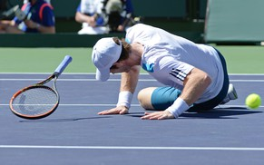 Mar 12, 2014; Indian Wells, CA, USA; Andy Murray (GBR) falls on the court during his match against Milos Raonic (not pictured) during the BNP Paribas Open at the Indian Wells Tennis Garden. Raonic won 4-6, 7-5, 6-3. Mandatory Credit: Jayne Kamin-Oncea-USA TODAY Sports