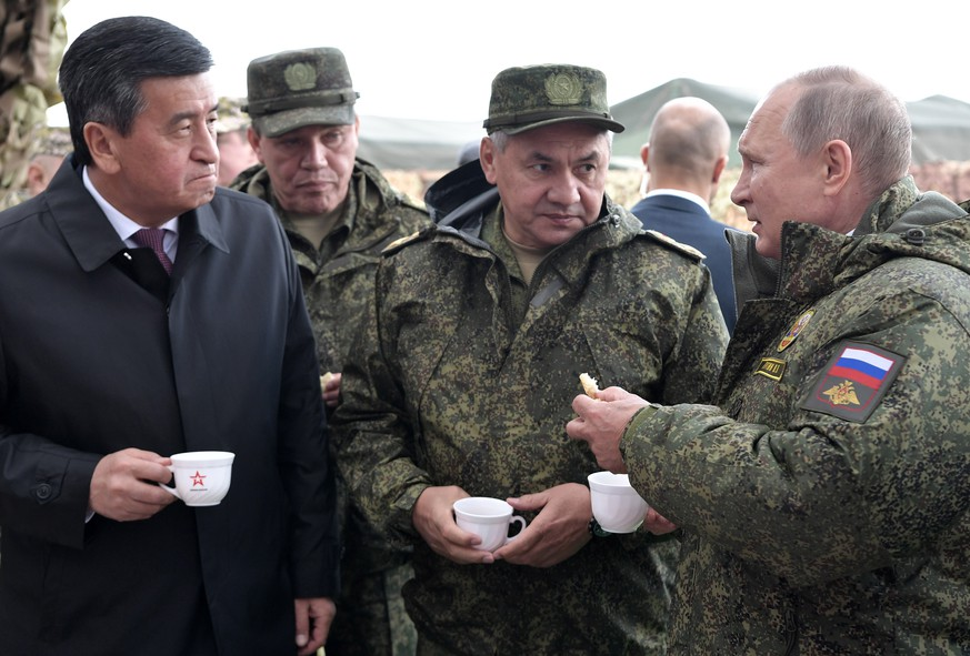 epa07855749 (L-R) Kyrgyzstan's President Sooronbay Jeenbekov, Chief of the General Staff of Russian Armed Forces Valery Gerasimov, Russian Defense Minister Sergei Shoigu and  Russian President Vladimir Putin  attend the main phase of the Center 2019 strategic military exercise at the Donguz test ground  outside Orenburg, Russia, 20 September 2019. The Center 2019 strategic command post exercise is held from 16 to 21 September on six training grounds of Russia and Kazakhstan. About 128 thousand military servicemen of Russia, China, Pakistan, Kyrgyzstan, Kazakhstan, India, Tajikistan and Uzbekistan, more than 20 thousand units of weapons, about 600 aircrafts and 15 war ships take part in the exercises.  EPA/ALEXEY NIKOLSKY / SPUTNIK / KREMLIN POOL MANDATORY CREDIT