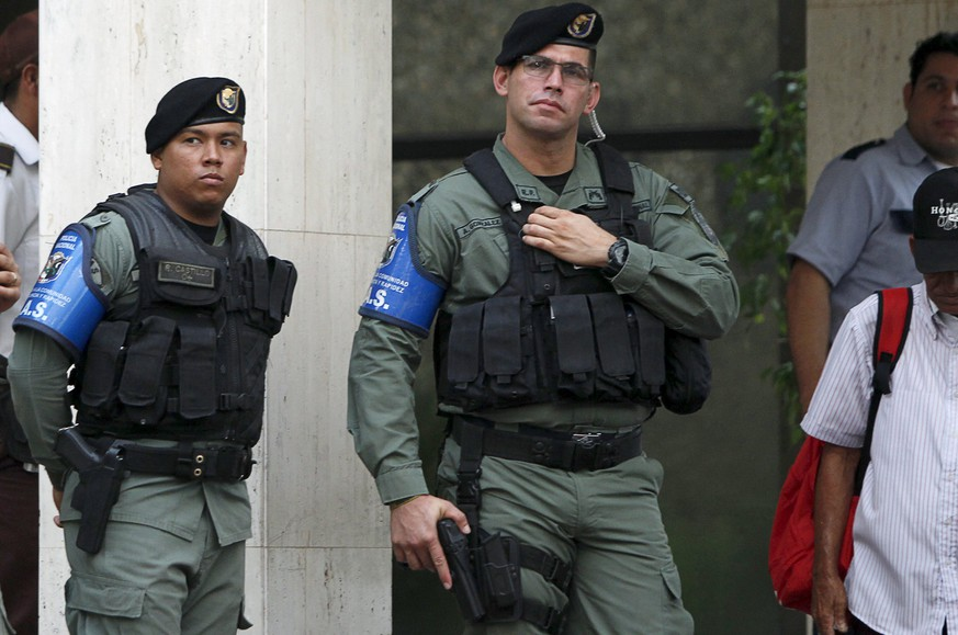 Police officers stand guard at the entrance of the Mossack Fonseca law firm office in Panama City April 12, 2016. REUTERS/Carlos Jasso