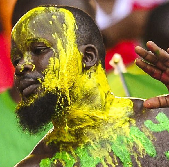 epa04597553 A Congo fan during the 2015 Africa Cup of Nations football match between Congo and DR Congo at the Bata Stadium in Bata, Equatorial Guinea 31 January 2015.  EPA/BARRY ALDWORTH UK AND IRELAND OUT