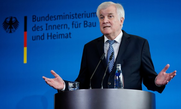 epa07031745 German Minister of Interior, Construction and Homeland Horst Seehofer speaks during a press conference, in Berlin, Germany, 19 September 2018. One day after a meeting of the party leaders of the government parliamentary groups in the German Bundestag Seehofer informs on the agreement reached in the evening of 18 September 2018. Coalition party leaders agreed on a transfer of the German Federal Office for the Protection of the Constitution in the Ministry of Interior as State Secretary. The German domestic intelligence chief Maassen was under pressure by several politicians for denying far-right extremists had 'hunted' foreigners at Chemnitz protests.  EPA/ALEXANDER BECHER
