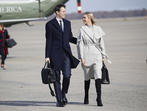 White House Senior Adviser Jared Kushner, left and Ivanka Trump, right, the daughter and assistant to President Donald Trump, walk across the tarmac before boarding Air Force One, Thursday, Nov. 29, 2018 at Andrews Air Force Base, Md. (AP Photo/Pablo Martinez Monsivais)