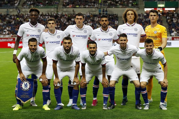 Players of Chelsea FC pose for group photo before their friendly soccer match against FC Barcelona, in Saitama, north of Tokyo, Tuesday, July 23, 2019. (AP Photo/Eugene Hoshiko)
