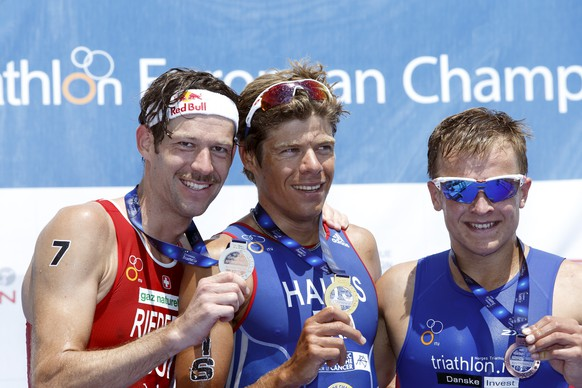Sven Riederer, of Switzerland, silver medal, David Hauss of France, gold medal, and Kristian Blummenfelt, of Norway, bronze, from left to richt, pose on the podium during the medal ceremony of the ITU Triathlon European Championships, in Geneva, Switzerland, Saturday, July 11, 2015. (KEYSTONE/Salvatore Di Nolfi)