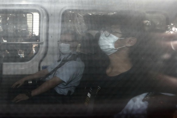 Former Studentlocalism leader Tony Chung arrives at a court on a police van after he was arrested under the national security law, in Hong Kong, Thursday, Oct. 29, 2020. Chung, former leader of Hong Kong pro-independence student group Studentlocalism, was denied bail after being charged with secession under the city's national security law. Chung was arrested and detained on Tuesday, his second arrest in months after he was first apprehended in July over social media content advocating for Hong Kong's independence. (AP Photo)