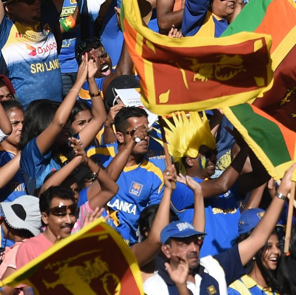 epa04637723 Sri Lankan fans wave national flags during their ICC Cricket World Cup match between Sri Lanka and Bangladesh at the Melbourne Cricket Ground (MCG), in Melbourne, Victoria, Australia, 26 February 2015.  EPA/JULIAN SMITH  -- AUSTRALIA AND NEW ZEALAND OUT -- IMAGES TO BE USED FOR NEWS REPORTING PURPOSES ONLY, NO COMMERCIAL USE WHATSOEVER, NO USE IN BOOKS WITHOUT PRIOR WRITTEN CONSENT FROM AAP