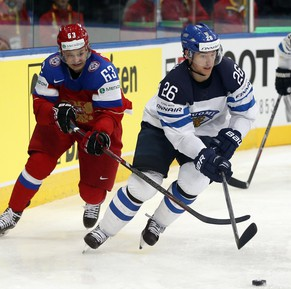 Finland forward Jarkko Immonen, center, is challenged by Russia forward Yevgeni Dadonov during the Group B preliminary round match between Russia and Finland at the Ice Hockey World Championship in Minsk, Belarus, Sunday, May 11, 2014. (AP Photo/Darko Bandic)