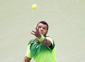 Jo-Wilfried Tsonga, of France, serves the ball against Novak Djokovic, of Serbia,  during a men's third round match at the Rogers Cup tennis tournament action in Toronto Thursday, Aug. 7, 2014. (AP Photo/The Canadian Press, Nathan Denette)