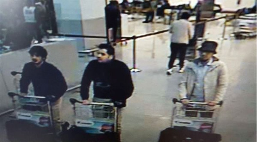 TOPSHOT - A picture released on March 22, 2016 by the belgian federal police on demand of the Federal prosecutor shows a screengrab of the airport CCTV camera showing suspects of this morning's attacks at Brussels Airport, in Zaventem. 