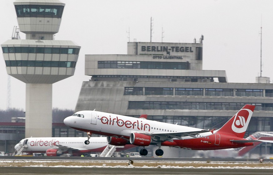 FILE - In this Jan. 20, 2013 file photo an airplane of the airline 'airberlin' lifts off at the airport Tegel in Berlin. Plans to replace Berlin's three small airports with a shiny new one have hit a fresh bump, after campaigners collected enough signatures to force a referendum on keeping a second site open. Officials said Tuesday, April 4, 2017 that over 200,000 people have signed a petition demanding that the Tegel airport in the northwest of the capital remain in operation.  (AP Photo/Michael Sohn, file)