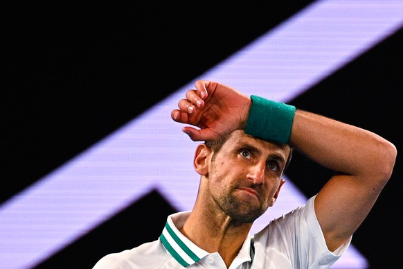 epa09011754 Novak Djokovic of Serbia reacts during his men's singles fourth round match against Milos Raonic of Canada at the Australian Open Grand Slam tennis tournament at Melbourne Park in Melbourne, Australia, 14 February 2021.  EPA/DEAN LEWINS  AUSTRALIA AND NEW ZEALAND OUT