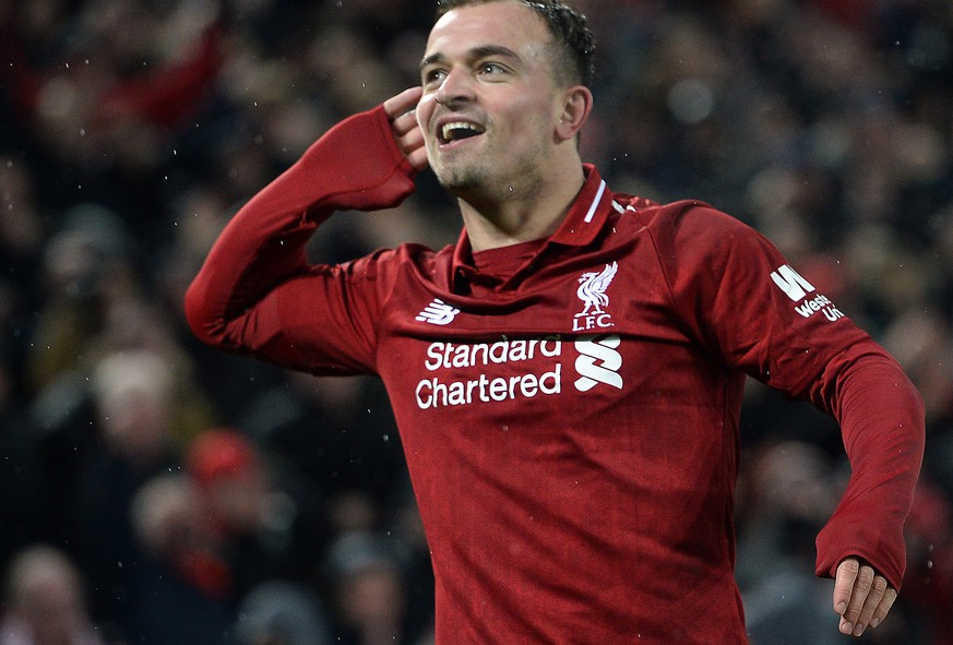 epa07236059 Xherdan Shaqiri of Liverpool celebrates after scoring the 3-1 goal during the English Premier League soccer match between Liverpool FC and Manchester United FC at Anfield in Liverpool, Britain, 16 December 2018.  EPA/PETER POWELL EDITORIAL USE ONLY. No use with unauthorized audio, video, data, fixture lists, club/league logos or 'live' services. Online in-match use limited to 120 images, no video emulation. No use in betting, games or single club/league/player publications.