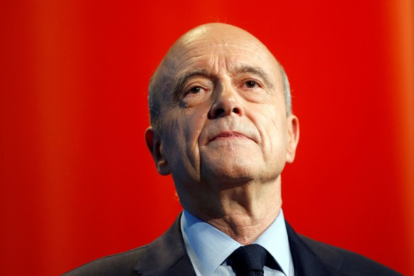 French presidential hopeful Alain Juppe, seeking to win his centre-right Les Republicains party's nomination in primaries in November, attends a political rally in Paris, France, May 10, 2016. REUTERS/Charles Platiau