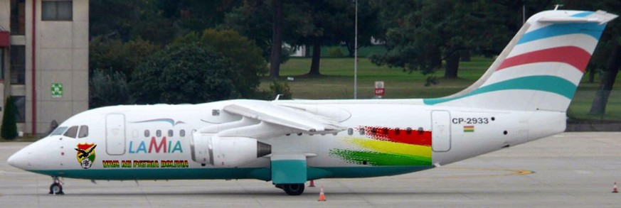 This photo released by the Bolivian Soccer Federation Tuesday, Nov. 29, 2016, shows the doomed BAE 146 Avro RJ85 LaMia jet, registration CP-2933, parked at the Viru Viru airport in Santa Cruz, Bolivia, Oct. 4, 2016. There are indications that the LaMia jet ran out of fuel, moments before crashing into the Andes near Medellin, on Monday evening. It is not known whether the lack of fuel was because they did not have enough for the flight, a leak or for some other reason. (Andres Dorado/Bolivian Soccer Federation via AP)