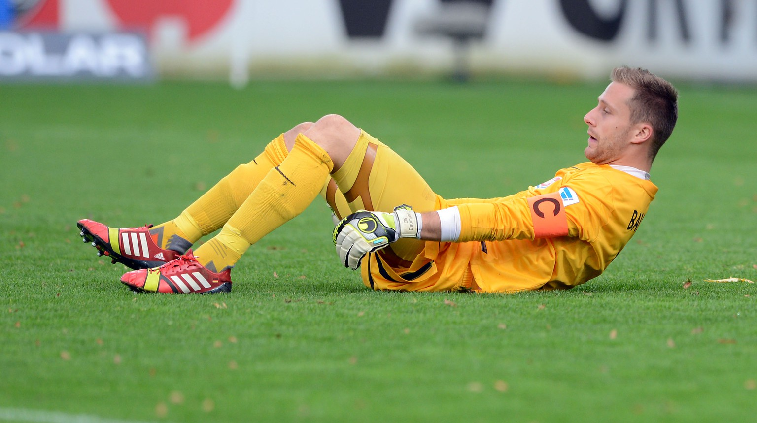 FREIBURG, GERMANY - OCTOBER 27:  Goalkeeper Oliver Baumann of Freiburg looksdejected after his second mistake during the Bundesliga match between SC Freiburg and Hamburger SV at Mage Solar Stadium on October 27, 2013 in Freiburg, Germany.  (Photo by Michael Kienzler/Bongarts/Getty Images)
