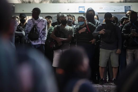 Commuters wait for a public Rapid Transit Bus (BRT) during the COVID-19 pandemic in Rio de Janeiro, Brazil, Friday, July 23, 2021, during the COVID-19 pandemic. (AP Photo/Bruna Prado)