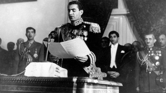 In this Feb. 16, 1950 picture, the Shah of Iran Mohammad Reza Pahlavi reads his inaugural speech at the initial session of his nation's first senate in Tehran, Iran. The popular revolt against the shah raised alarm bells in the West, which saw the shah as a trusted ally and counterweight to hard-line Arab regimes and Palestinian radicals. The face of the revolution was Ayatollah Ruhollah Khomeini, whose demeanor, vehemently anti-American rhetoric and stern interpretation of Islam challenged not only Western interests but also Western values. (AP Photo)