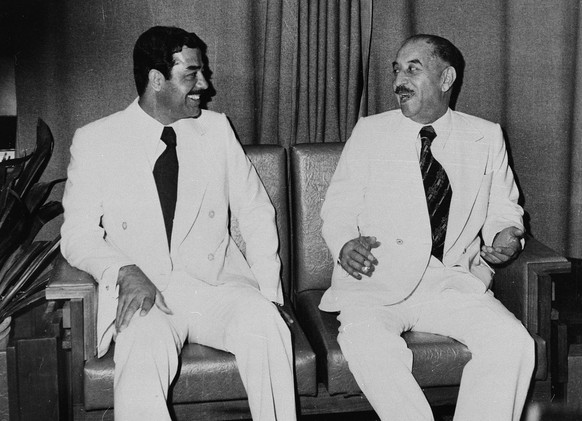 ** FILE ** Then Iraqi President Ahmed Hassan el Bakr, right, and Saddam Hussein are pictured in Baghdad in this November 1978 file photo.  (AP Photo/file)
