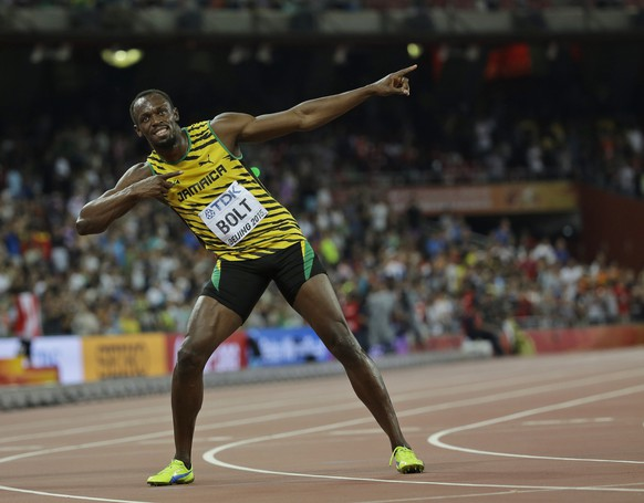 Jamaica's Usain Bolt celebrates after winning the men's 100m final at the World Athletics Championships at the Bird's Nest stadium in Beijing, Sunday, Aug. 23, 2015. (AP Photo/David J. Phillip)