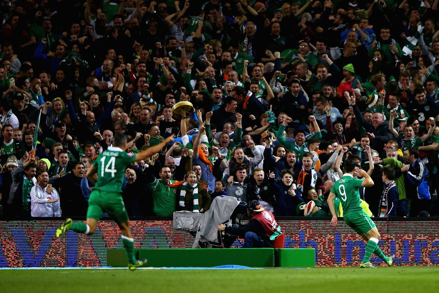 DUBLIN, IRELAND - OCTOBER 08:  Shane Long of Republic of Ireland (R) celebrates scoring the opening goal in front of the fans during the UEFA EURO 2016 Qualifier group D match between Republic of Ireland and Germany at the Aviva Stadium on October 8, 2015 in Dublin, Ireland.  (Photo by Ian Walton/Getty Images)