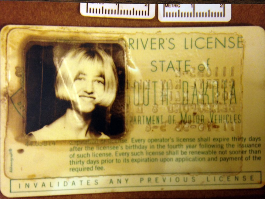 In this undated photo provided by the South Dakota Attorney Generals Office, Cheryl Miller's driver's license is seen. Two South Dakota girls on their way to an end-of-school-year party at a gravel pit in May 1971 drove off a country road into a creek and remained hidden until last fall when a drought brought their car into view, authorities said Tuesday, April 15, 2014. State and local officials held a news conference Tuesday afternoon confirming that the 1960 Studebaker unearthed in September included the remains of Cheryl Miller and Pamella Jackson, both 17-year-olds who attended Vermillion High School. (AP Photo/South Dakota Attorney Generals Office)