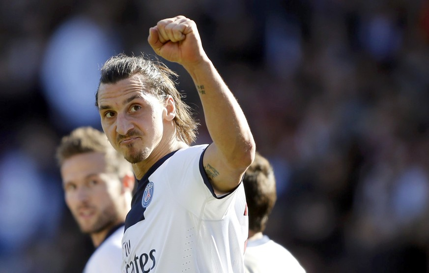 Paris St Germain's Zlatan Ibrahimovic celebrates after he scored against Toulouse during their French Ligue 1 soccer match at the Stadium in Toulouse, February 23, 2014.  REUTERS/Regis Duvignau (FRANCE  - Tags: SPORT SOCCER)