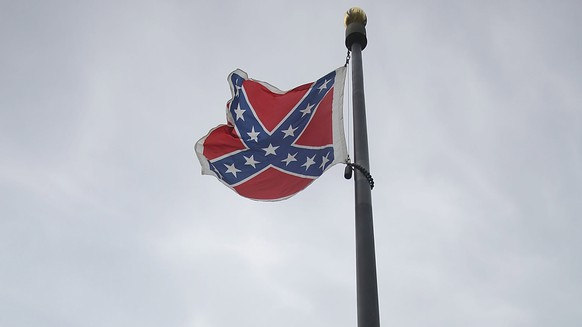 COLUMBIA, SC - JUNE 22:  The Confederate flag flies on the Capitol grounds after South Carolina Gov. Nikki Haley announced that she will call for the Confederate flag to be removed on June 22, 2015 in Columbia, South Carolina. Debate over the flag flying at the Capitol was again ignited off after nine people were shot and killed during a prayer meeting at the Emanuel African Methodist Episcopal Church in Charleston, South Carolina.   (Photo by Joe Raedle/Getty Images) *** BESTPIX ***
