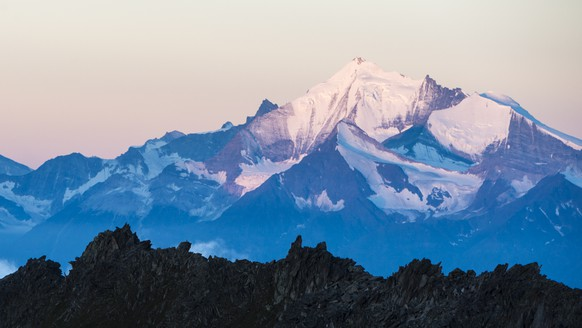 The Matterhorn mountain, left, and the Weisshorn moutain, right, after sunrise with the view out of Eggishorn moutain, in Fiesch, Switzerland, early Tuesday, July 28, 2015. (KEYSTONE/Dominic Steinmann)