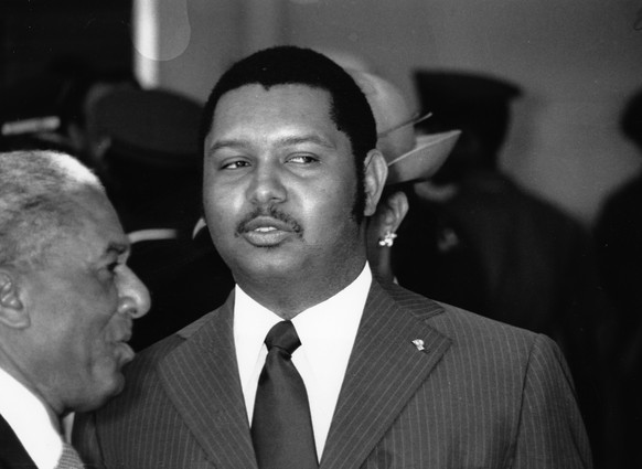 FILE - In this April 25, 1975 file phot, Haitian President Jean-Claude Duvalier welcomes Zambian President Kenneth Kaunda at the Port-au-Prince airport in Haiti.  Duvalier, the self-proclaimed