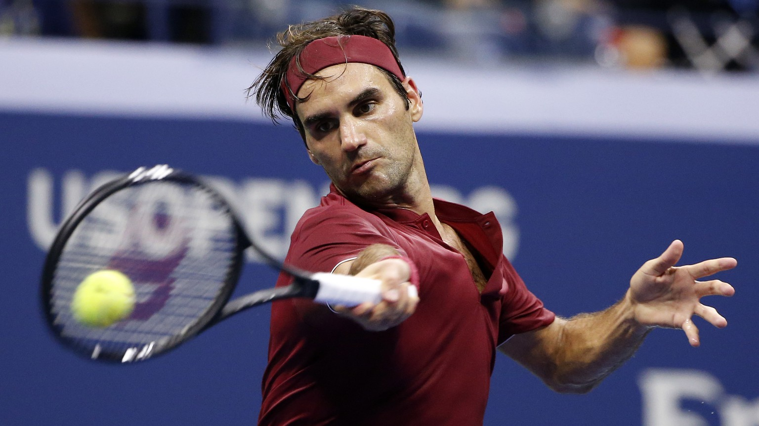 Roger Federer, of Switzerland, returns a shot to John Millman, of Australia, during the fourth round of the U.S. Open tennis tournament early Tuesday, Sept. 4, 2018, in New York. (AP Photo/Jason DeCrow)