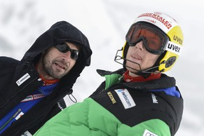 Reto Schmidiger of Switzerland, right, talks with Steve Locher, Swiss-Ski coach, left, before the first run of the men's Slalom race at the FIS Alpine Ski World Cup in Val d'Isere, France, Saturday, December 8, 2012. (KEYSTONE/Jean-Christophe Bott)