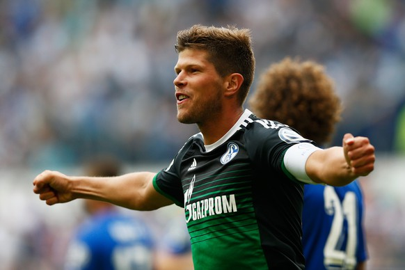DUISBURG, GERMANY - AUGUST 08:  Klaas-Jan Huntelaar of FC Schalke 04 celebrates after he shoots and scores a goal in the opening minutes during the DFB Cup match between MSV Duisburg and FC Schalke 04 held at Schauinsland-Reisen-Arena on August 8, 2015 in Duisburg, Germany.  (Photo by Dean Mouhtaropoulos/Bongarts/Getty Images)